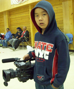 Arviat youth with camera